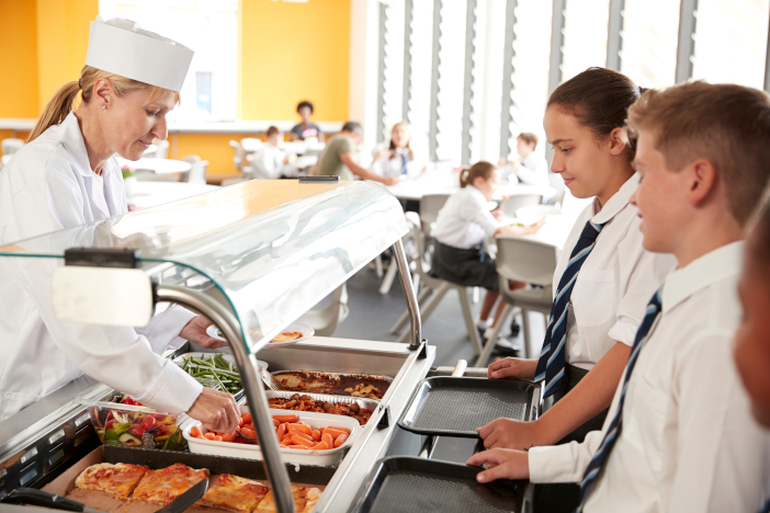 High,School,Students,Wearing,Uniform,Being,Served,Food,In,Canteen